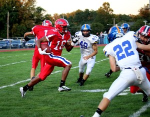 Denzel Hughes, above, made a run in the first quarter of the Neshaminy v. Downingtown West football game.