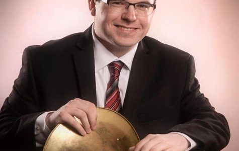 Steven Hopkins poses with his beloved french horn for his senior photos.