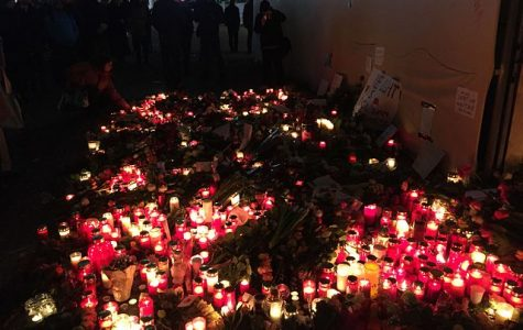 Germany mourned those lost in the Christmas market attack, holding vigils, as shown above.