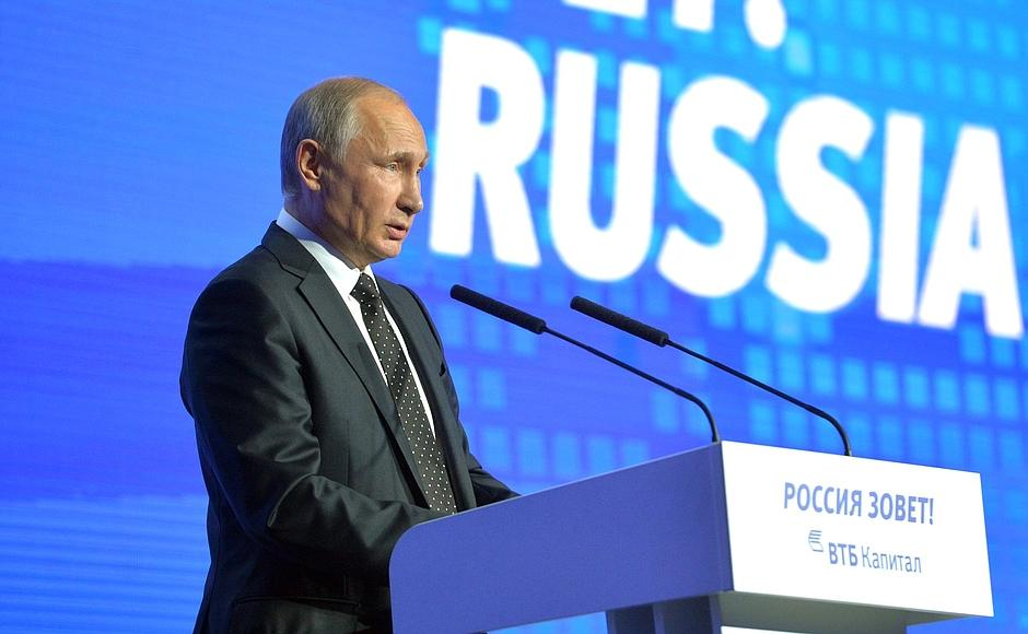Russian president Vladimir Putin delivers a speech at a forum.