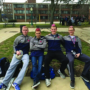 From left, current senior Josh Hartley and prior seniors Luka Kezherashvili, John Stay and Dave Kneiss are at La Salle University for the district one championships last year.