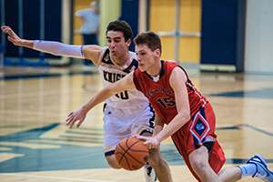 Junior Chris Arcidiacono dribbles past a defender in a game against West Chester Rustin High School.