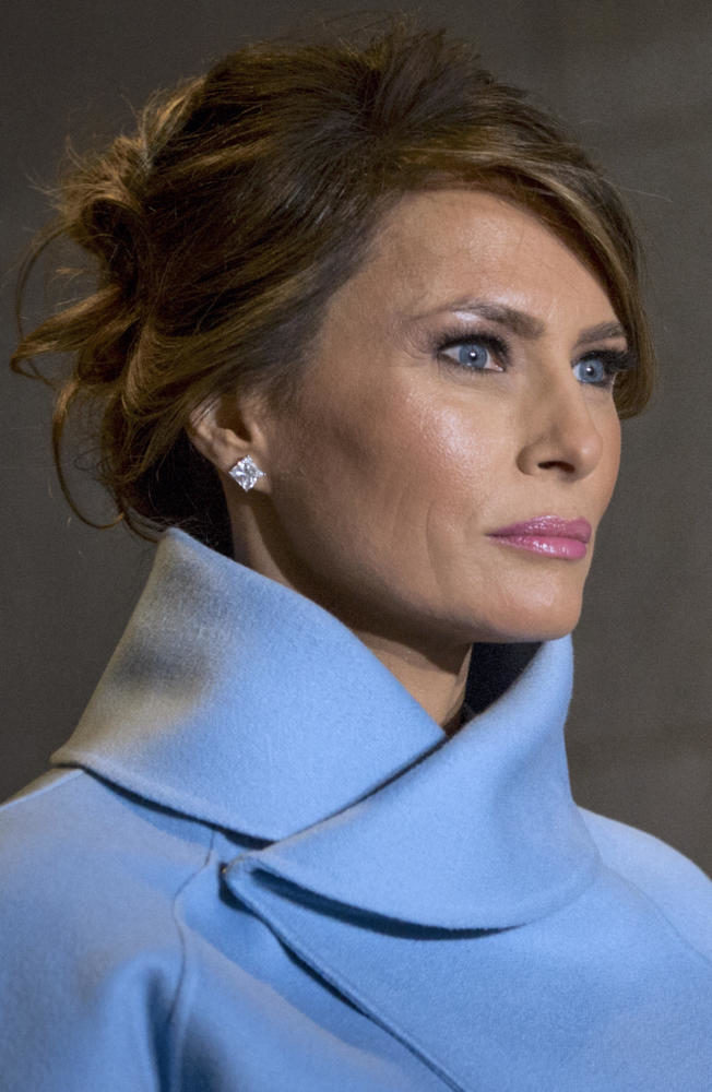 Melania+Trump%2C+escorted+by+a+U.S.+Marine%2C+walks+toward+the+platform+the+58th+Presidential+Inauguration+in+Washington%2C+D.C.%2C+Jan.+20%2C+2017.+More+than+5%2C000+military+members+from+across+all+branches+of+the+armed+forces+of+the+United+States%2C+including+reserve+and+National+Guard+components%2C+provided+ceremonial+support+and+Defense+Support+of+Civil+Authorities+during+the+inaugural+period.+%28DoD+photo+by+U.S.+Air+Force+Staff+Sgt.+Marianique+Santos%29