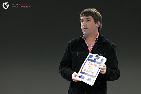 Stillshot of Hillenburg holding the SpongeBob SquarePants bible in 2011.