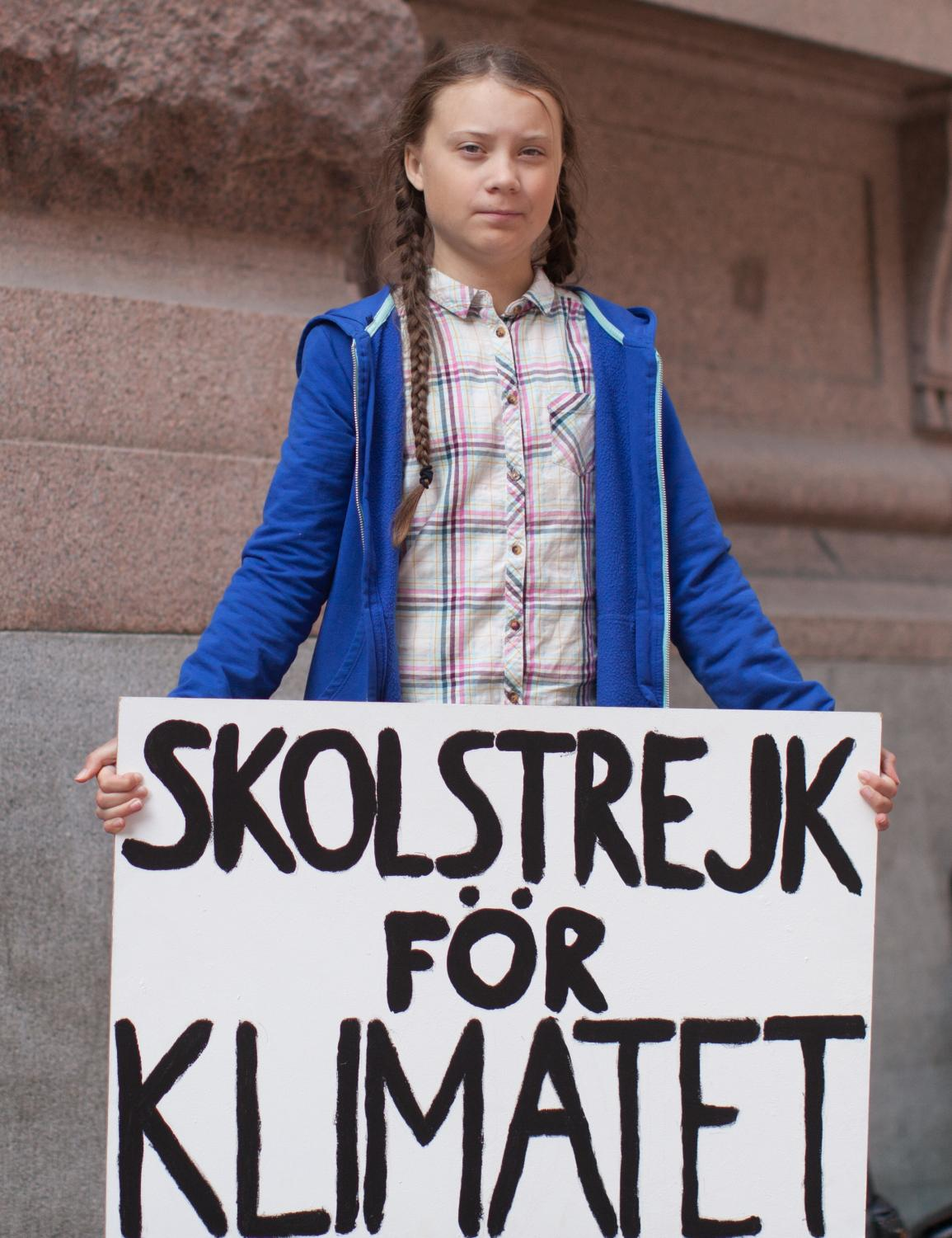 Greta Thunburg with her famous sign, which translates to