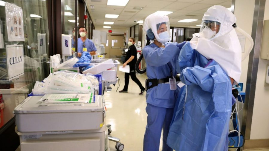 Rising COVID-19 cases are straining hospitals. Justin Sullivan/Getty Images