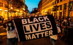 People hold up a Black Lives Matter banner as they march during a demonstration against racial inequality in the aftermath of the death in Minneapolis police custody of George Floyd, in Washington, U.S., June 14, 2020. REUTERS/Erin Scott